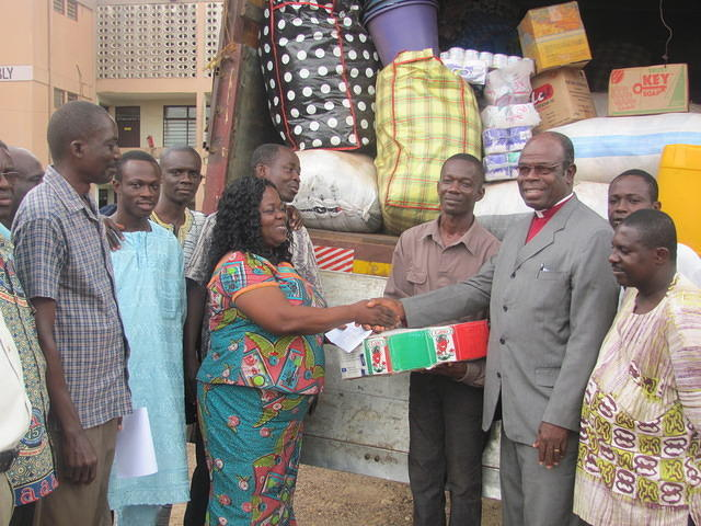 Part of the relief items being presented by Apostle S.N.Brako(2nd Rt.) to the Birim Central Municipal Chief Executive, Hon. Ophelia Koomson (Middle)