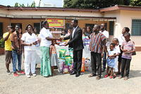 ACHIMOTA DISTRICT CHILDREN MAKING THE DONATION AT THE ACCRA PSYCHIATRIC HOSPITAL